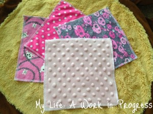 3 different cotton prints. Light pink minky on opposite side of each.