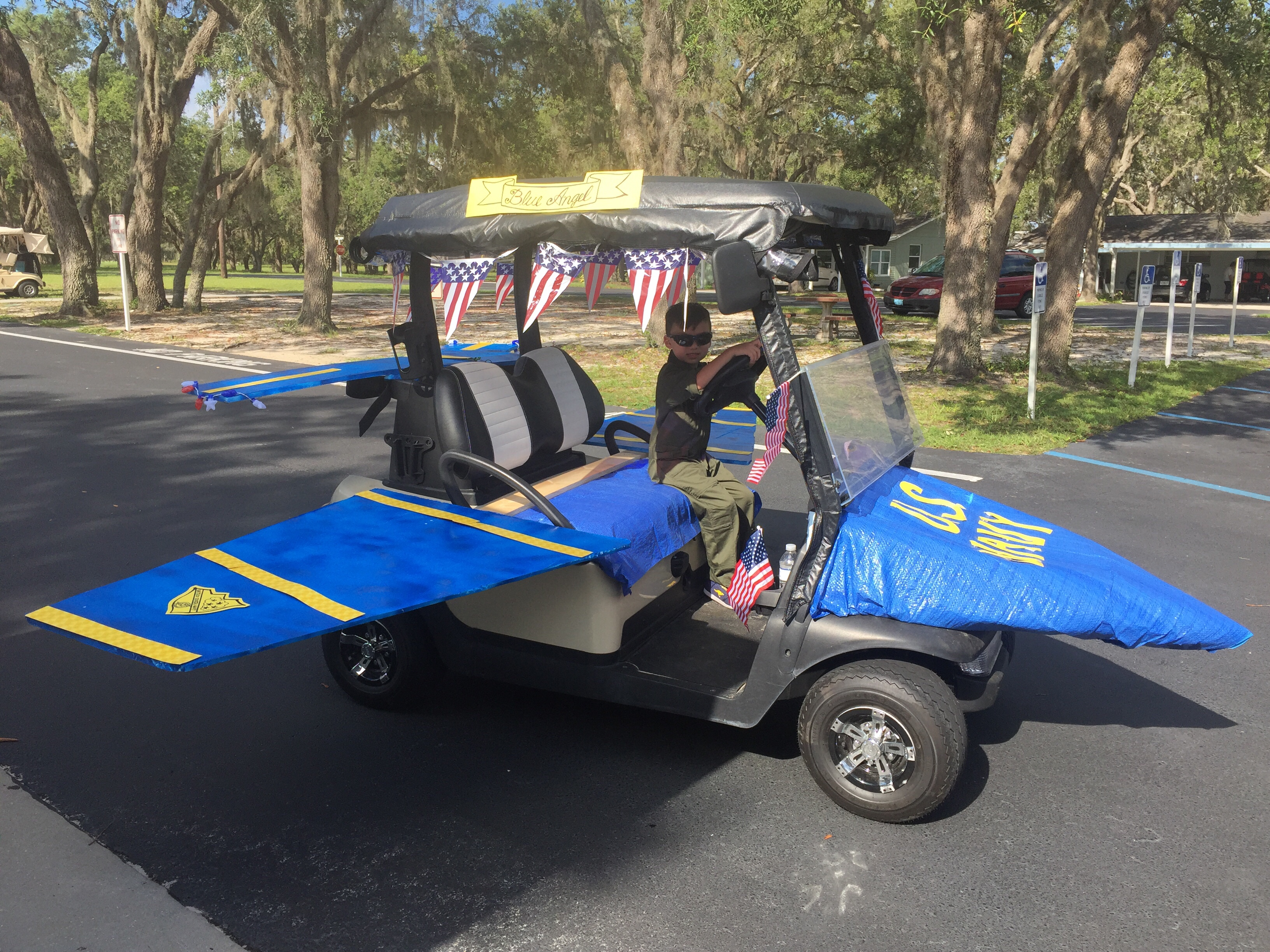 Decorate golf cart as U.S. Navy Blue Angels jet for patriotic July on custom concepts carts, mardi gras shopping carts, decorated doors, decorated shopping carts, old people extreme carts,